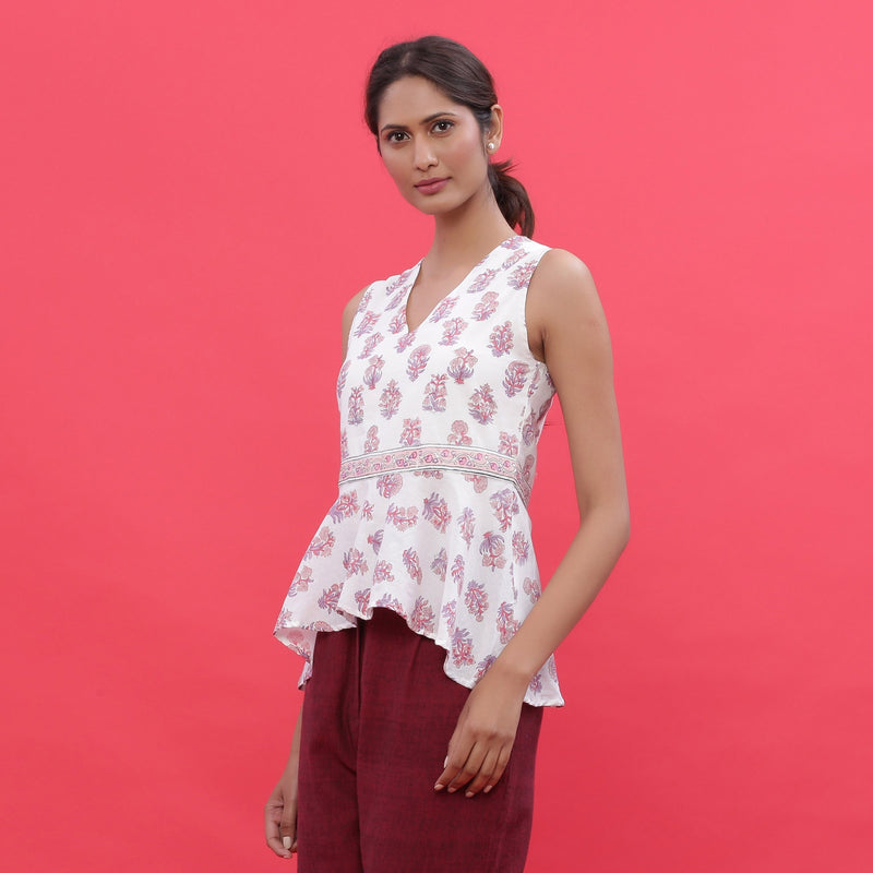 Left View of a Model wearing White Sanganeri Print High Low Top