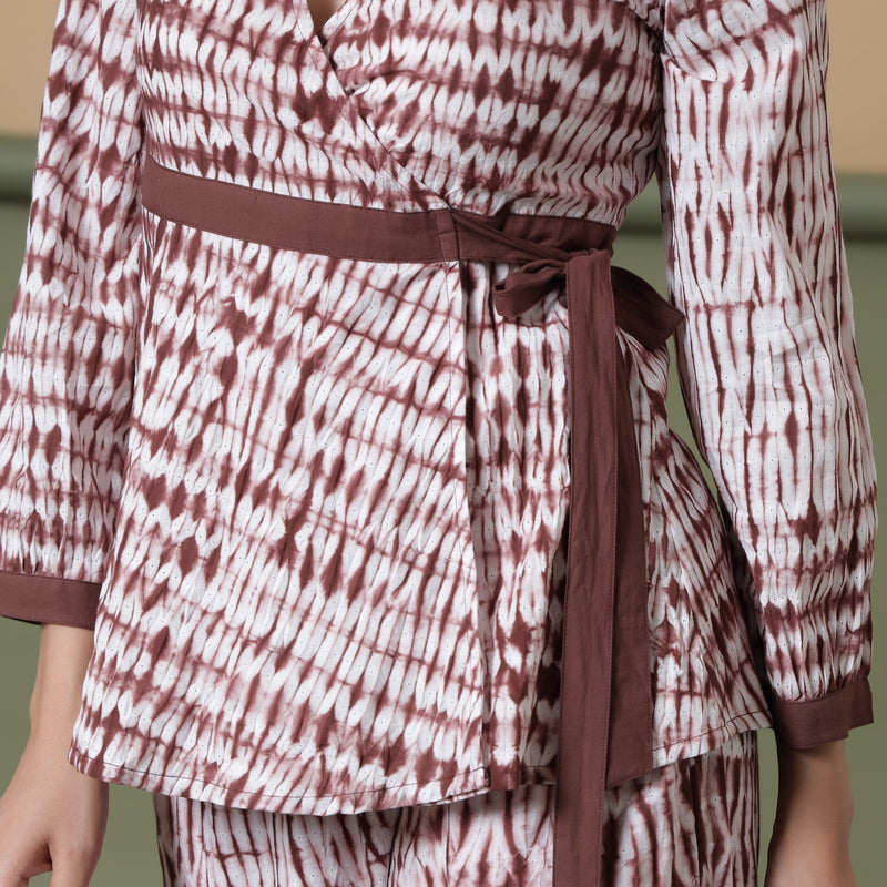Front Detail of a Model wearing Sangria Wine Shibori Wrap Top