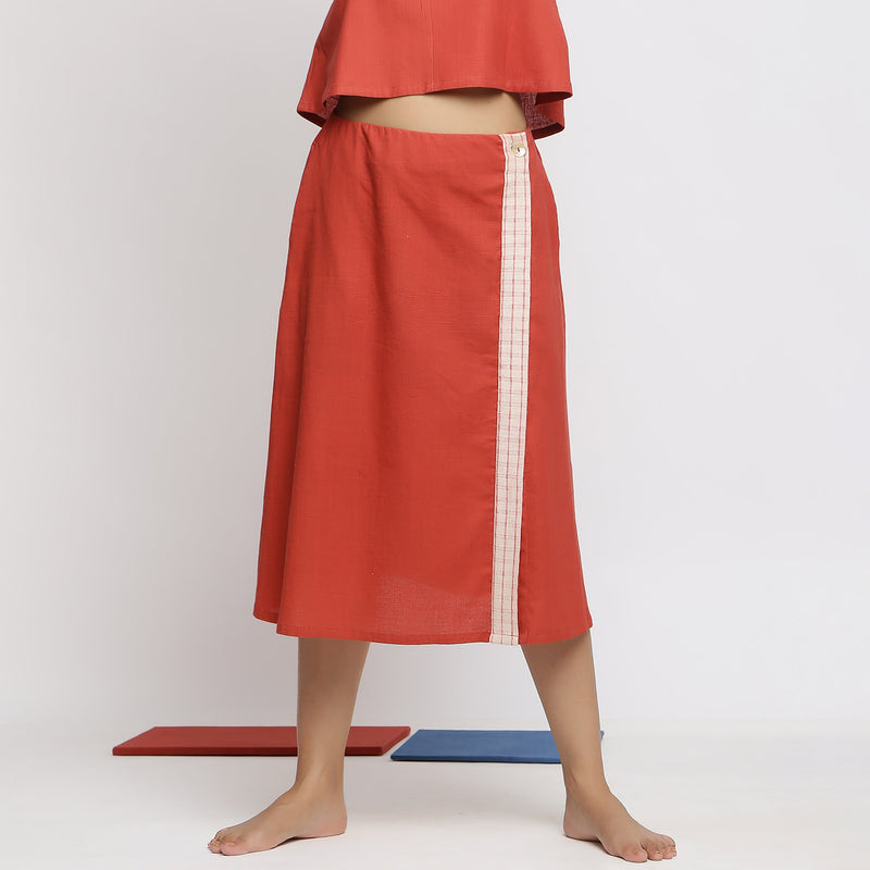 Front View of a Model wearing Vegetable Dyed Brick Red Button-Down Skirt