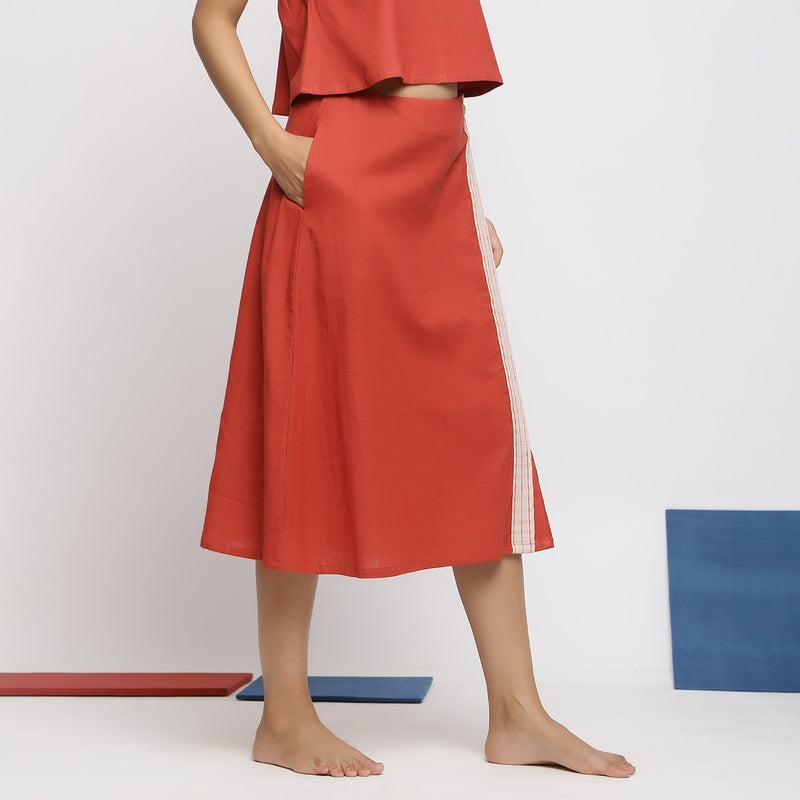 Right View of a Model wearing Vegetable Dyed Brick Red Button-Down Skirt