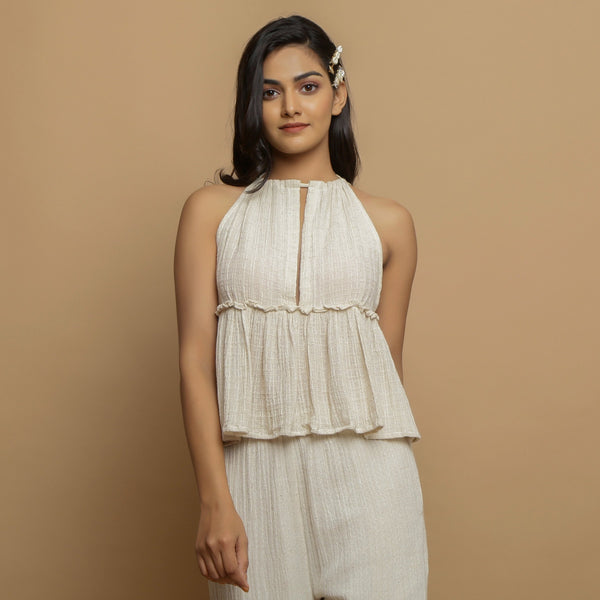 Front View of a Model wearing Ecru Cotton Flax Sleeveless Flared Top