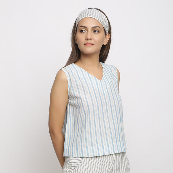 Right View of a Model wearing Handspun Asymmetrical V-Neck Wrap Top
