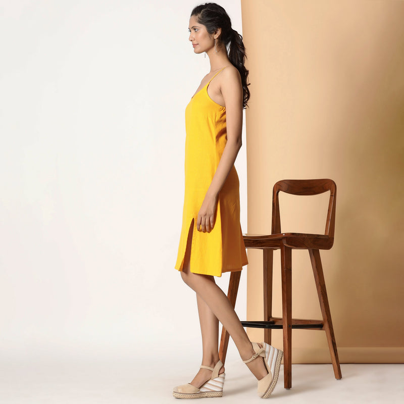 Left View of a Model wearing Sassy Yellow Cotton Flax Strappy Slit Dress
