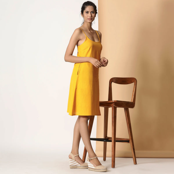 Right View of a Model wearing Sassy Yellow Cotton Flax Strappy Slit Dress