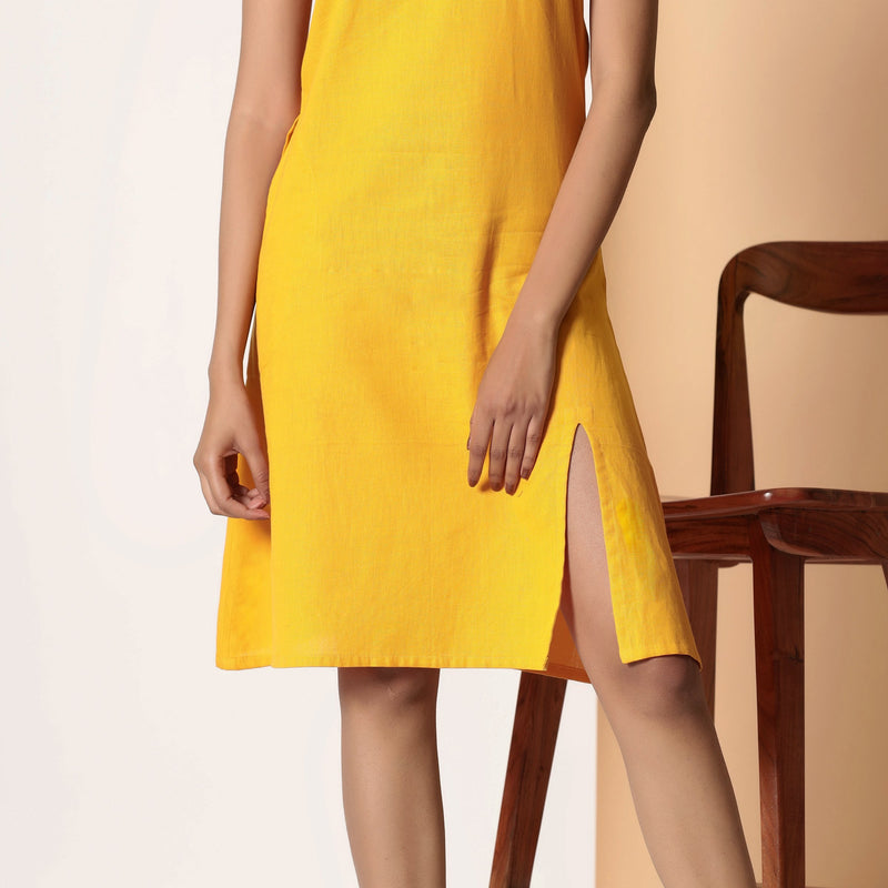 Front Detail of a Model wearing Sassy Yellow Cotton Flax Strappy Slit Dress
