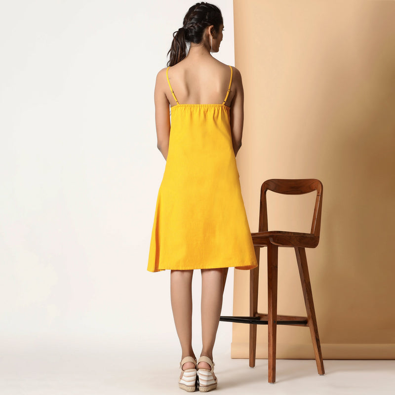 Back View of a Model wearing Sassy Yellow Cotton Flax Strappy Slit Dress