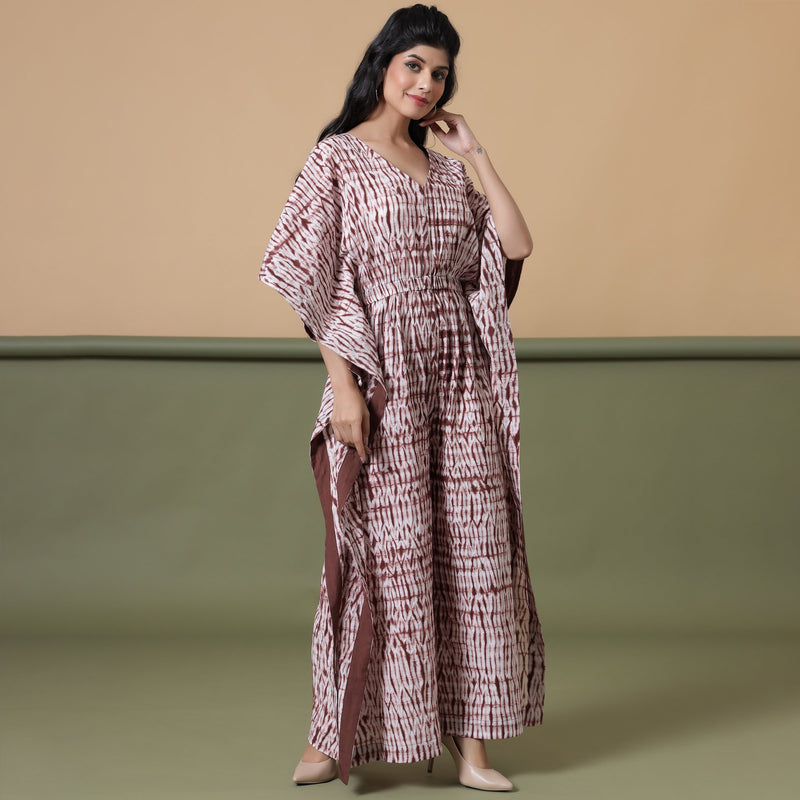 Right View of a Model wearing Shibori V-Neck Kaftan Jumpsuit