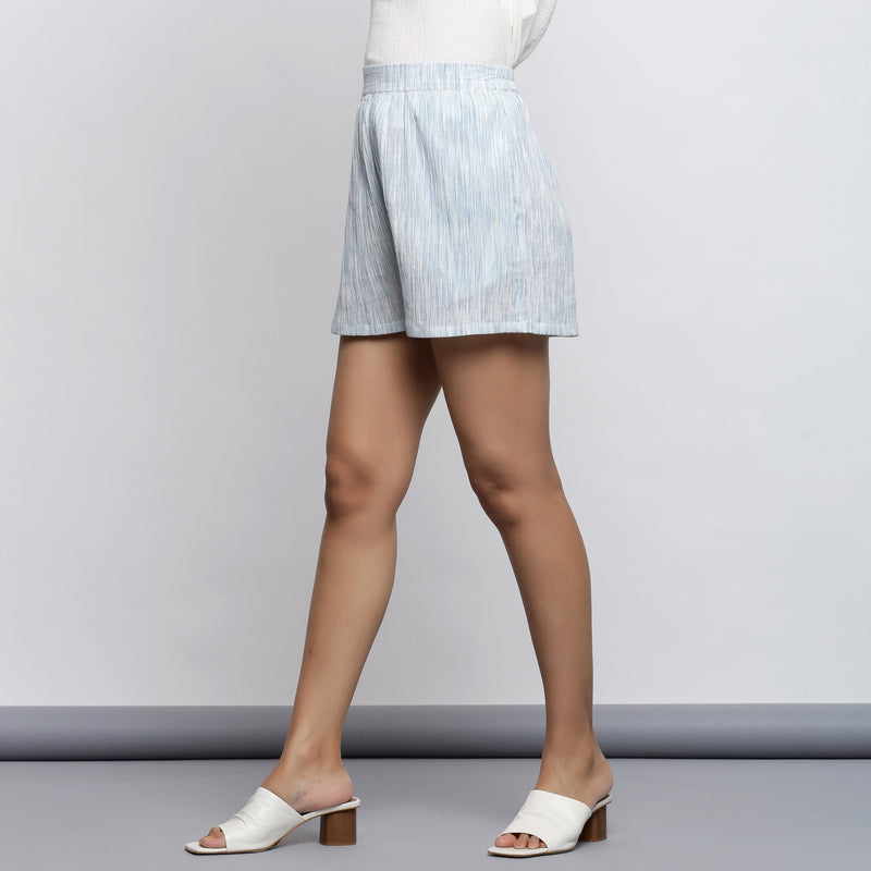 Left View of a Model wearing Sky Blue Crinkled Cotton Short Shorts