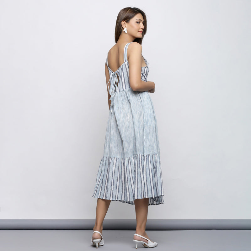 Back View of a Model wearing Sky Blue Tiered Yarn Dyed Striped Dress