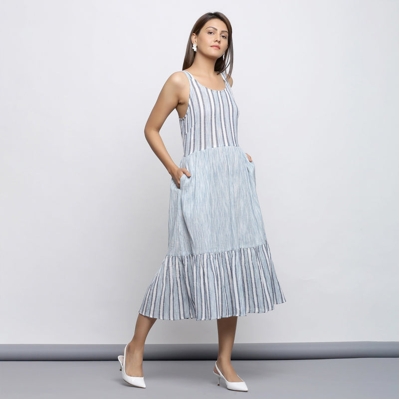 Right View of a Model wearing Sky Blue Tiered Yarn Dyed Striped Dress