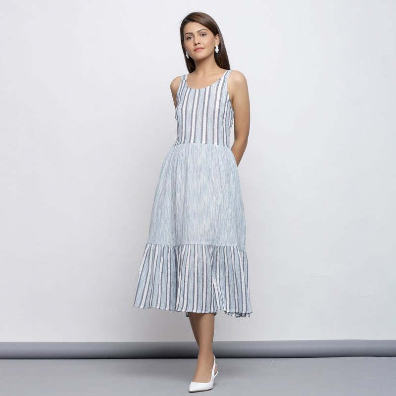 Front View of a Model wearing Sky Blue Tiered Yarn Dyed Striped Dress