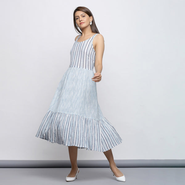 Left View of a Model wearing Sky Blue Tiered Yarn Dyed Striped Dress