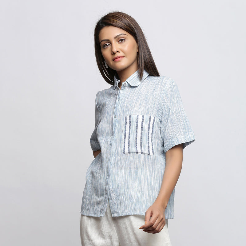 Left View of a Model wearing Sky Blue Yarn Dyed Button-Down Shirt