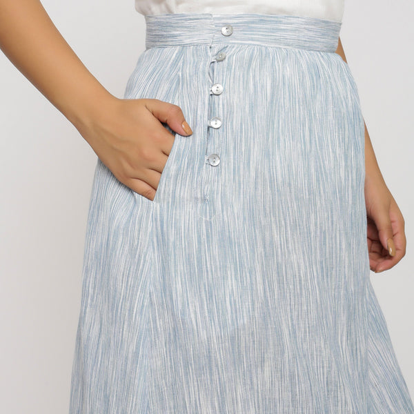 Right Detail of a Model wearing Sky Blue Yarn Dyed Cotton High Low Skirt
