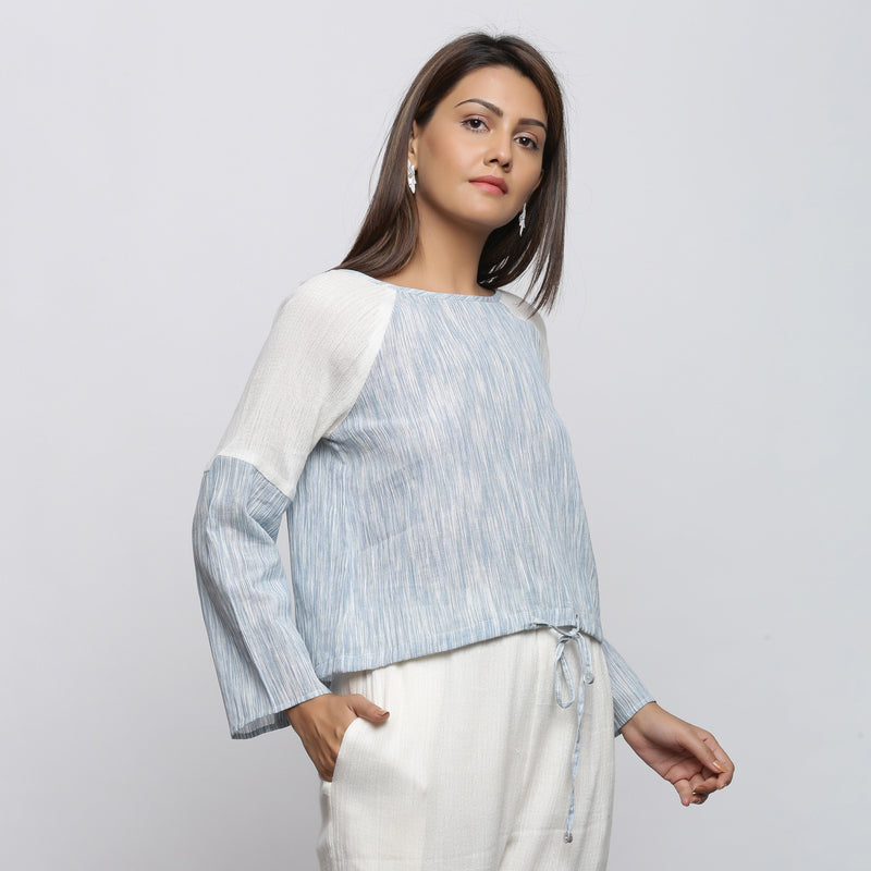 Right View of a Model wearing Sky Blue Yarn Dyed Cotton Straight Top