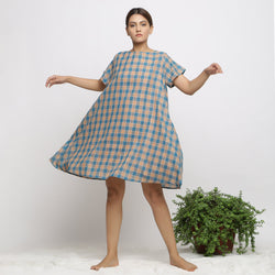 Front View of a Model wearing Soft Handspun Cotton Muslin Flared Dress