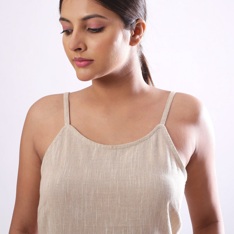 Front Detail of a Model wearing Solid Beige Cotton Flax Spaghetti Top