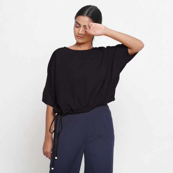 Front View of a Model wearing Solid Black Cotton Flax Blouson Top