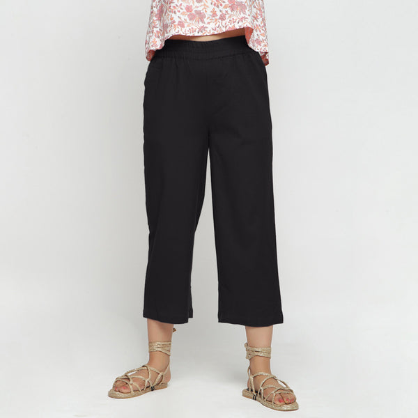 Front View of a Model wearing Solid Black Cotton Flax Culottes