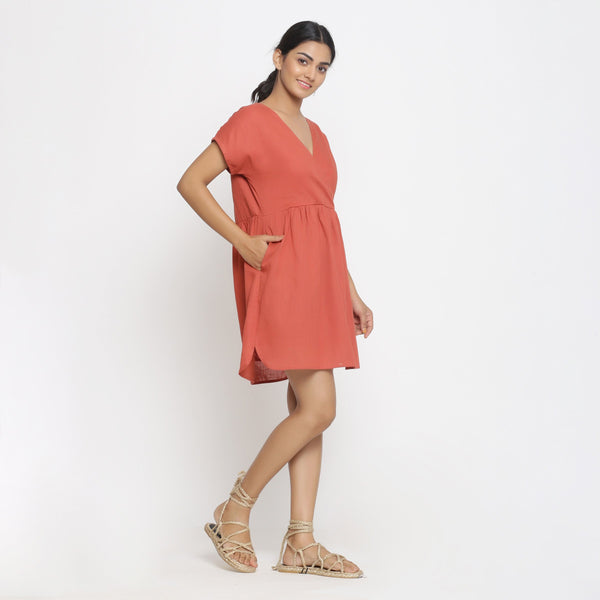Right View of a Model wearing Solid Brick Red Cotton Wrap Dress