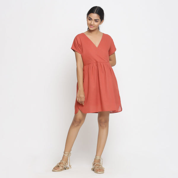 Front View of a Model wearing Brick Red Cotton Solid Wrap Dress