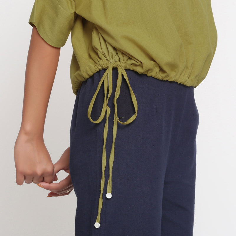Right Detail of a Model wearing Solid Green Cotton Flax Blouson Top