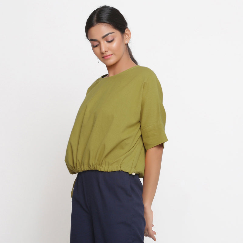 Left View of a Model wearing Solid Green Cotton Flax Blouson Top