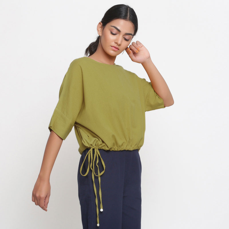 Right View of a Model wearing Solid Green Cotton Flax Blouson Top