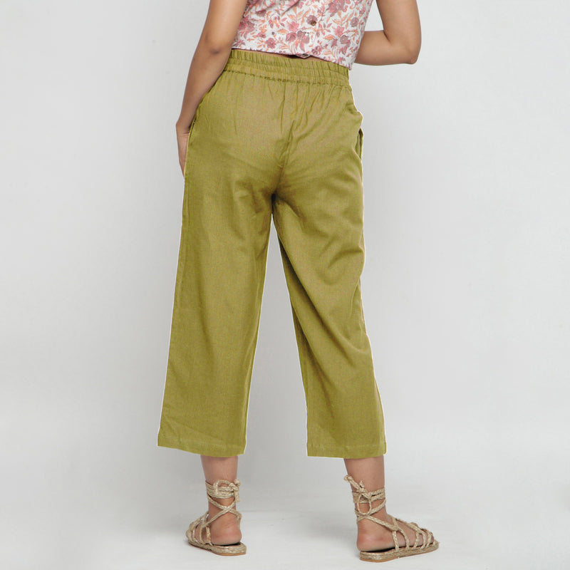 Back View of a Model wearing Solid Olive Green Cotton Flax Culottes