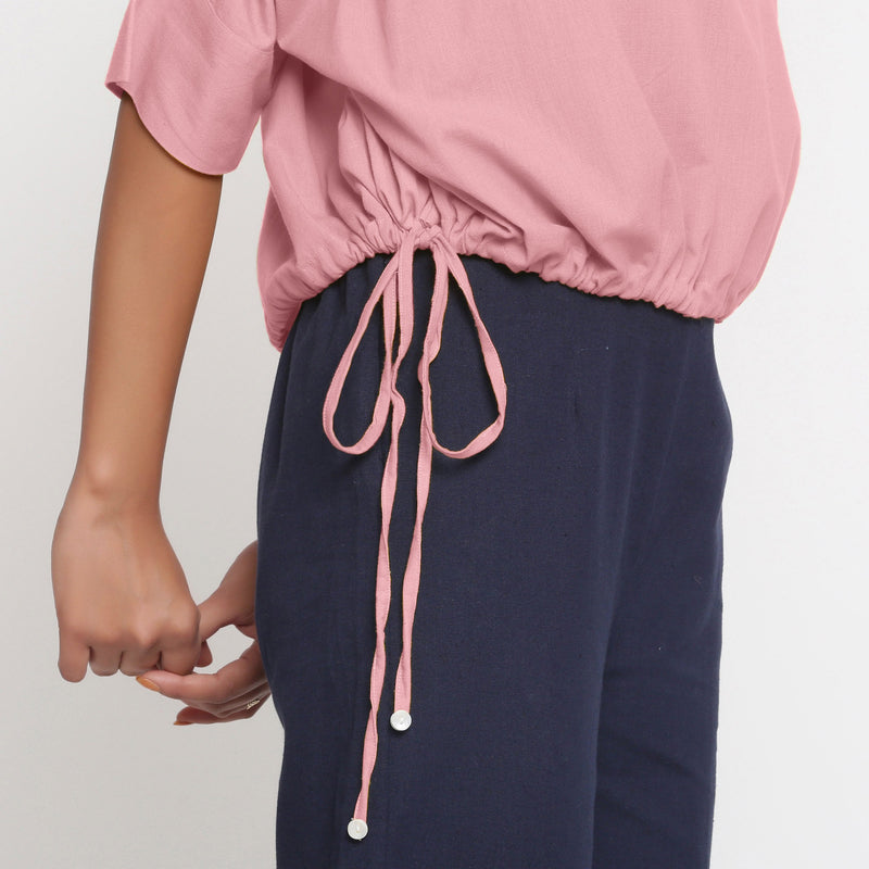 Right Detail of a Model wearing Solid Pink Cotton Flax Blouson Top