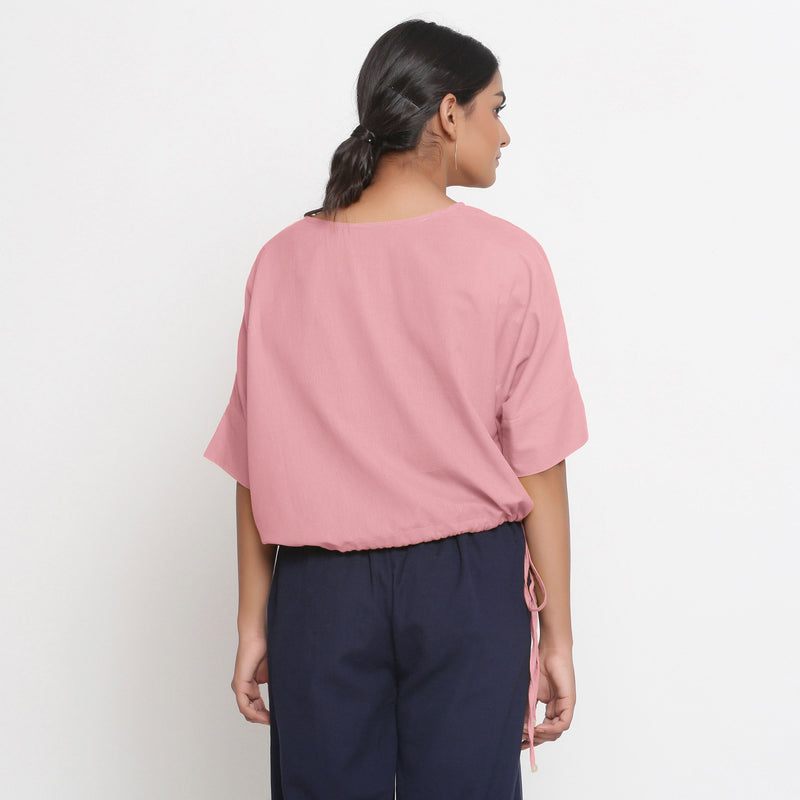 Back View of a Model wearing Solid Pink Cotton Flax Blouson Top
