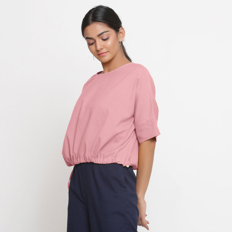 Left View of a Model wearing Solid Pink Cotton Flax Blouson Top