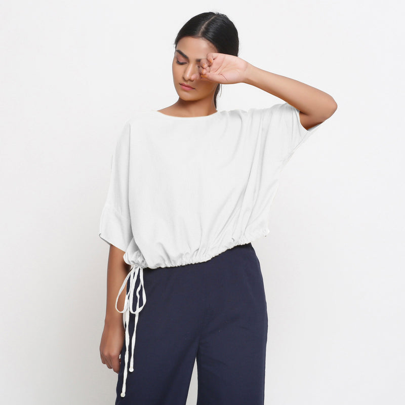 Front View of a Model wearing Solid White Cotton Flax Blouson Top