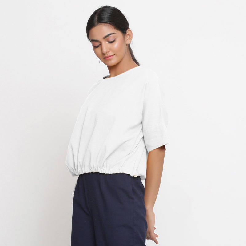 Left View of a Model wearing Solid White Cotton Flax Blouson Top