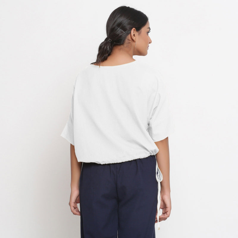 Back View of a Model wearing Solid White Cotton Flax Blouson Top