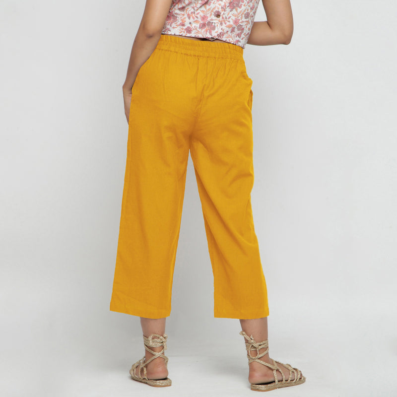 Back View of a Model wearing Solid Yellow Cotton Flax Culottes