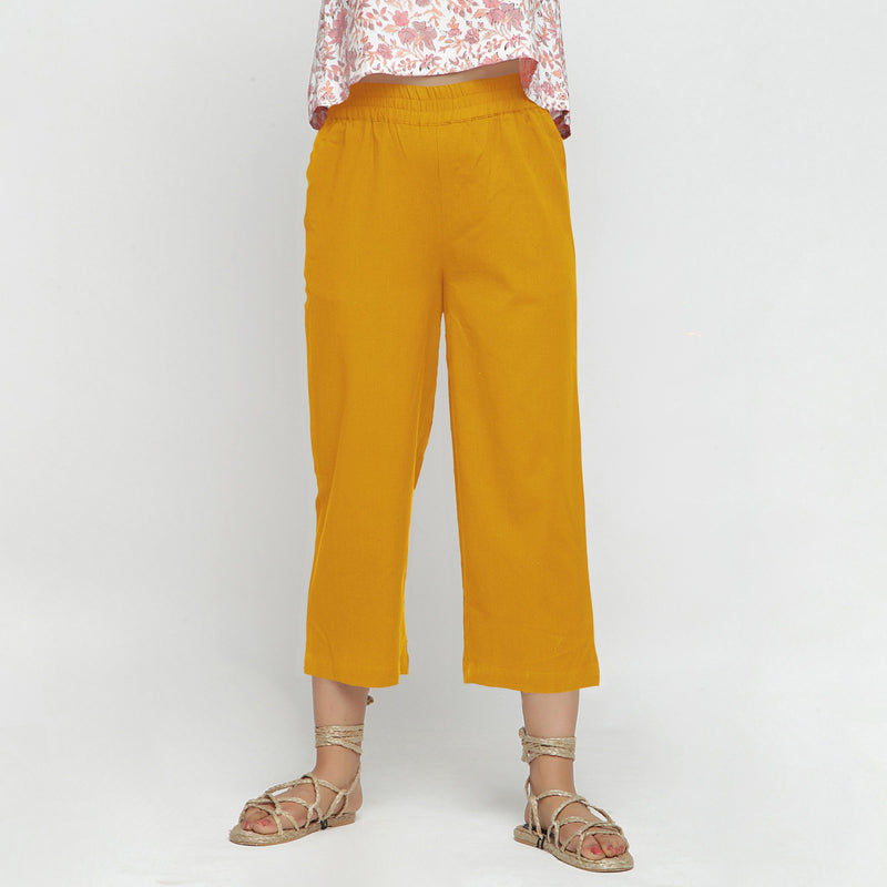 Front View of a Model wearing Solid Yellow Cotton Flax Culottes