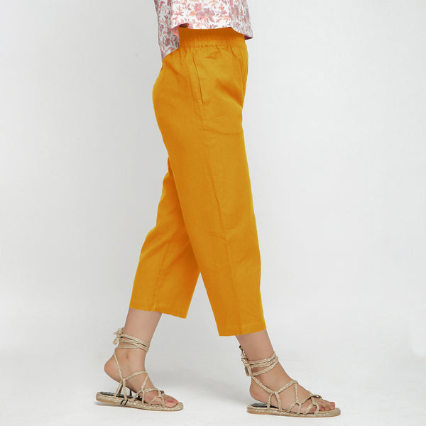 Right View of a Model wearing Solid Yellow Cotton Flax Culottes