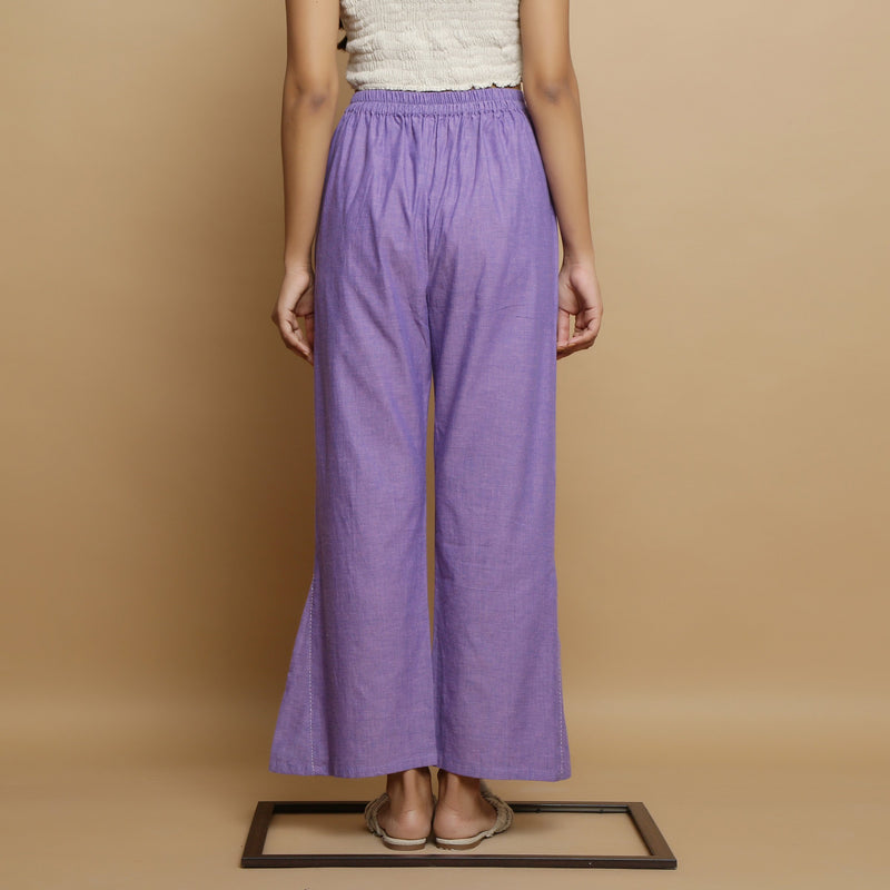 Back View of a Model wearing Lavender Aankle-Length Godet Pant