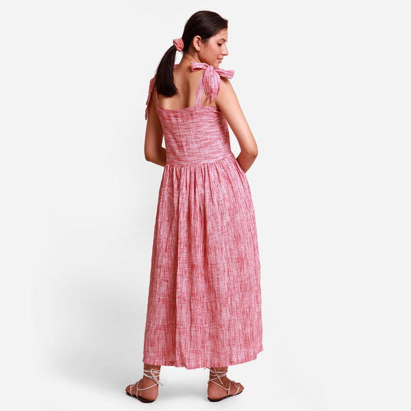 Back View of a Model wearing Strappy Button-Down Maxi Dress