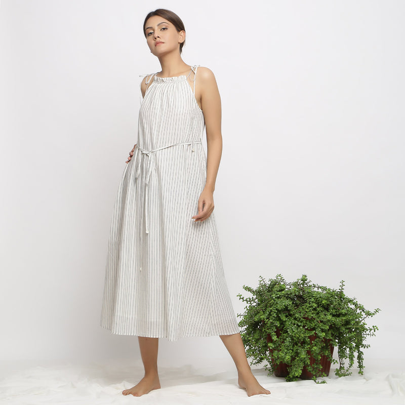 Front View of a Model wearing Strappy Handspun Flared Maxi Dress