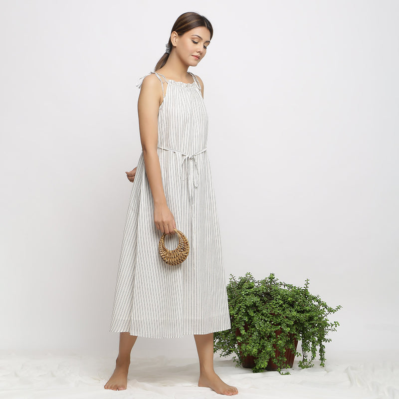 Right View of a Model wearing Strappy Handspun Flared Maxi Dress