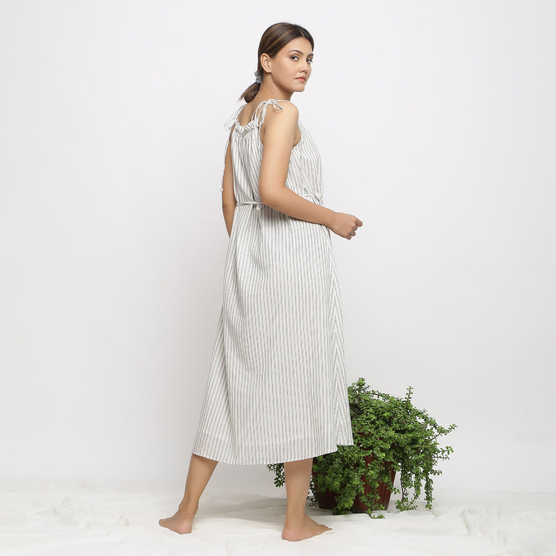 Back View of a Model wearing Strappy Handspun Flared Maxi Dress