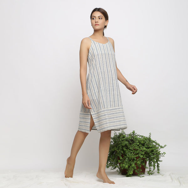Right View of a Model wearing Strappy Handspun Striped Shift Dress