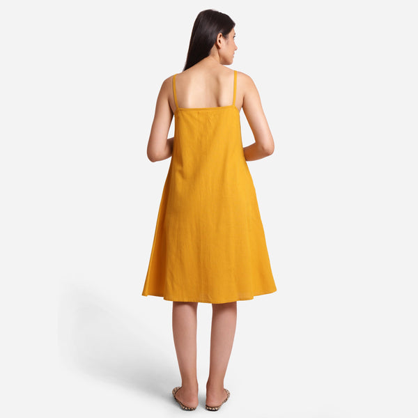 Back View of a Model wearing Mustard Cotton Flax Strappy Slit Dress