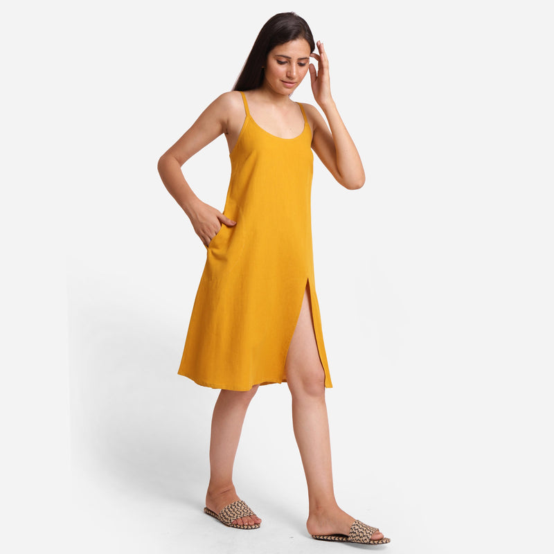 Right View of a Model wearing Mustard Cotton Flax Strappy Slit Dress