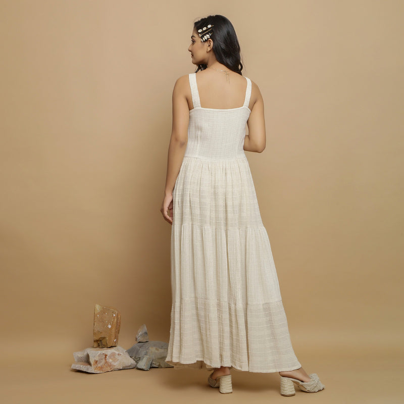 Back View of a Model wearing Strappy Undyed Cotton Flax Maxi Dress