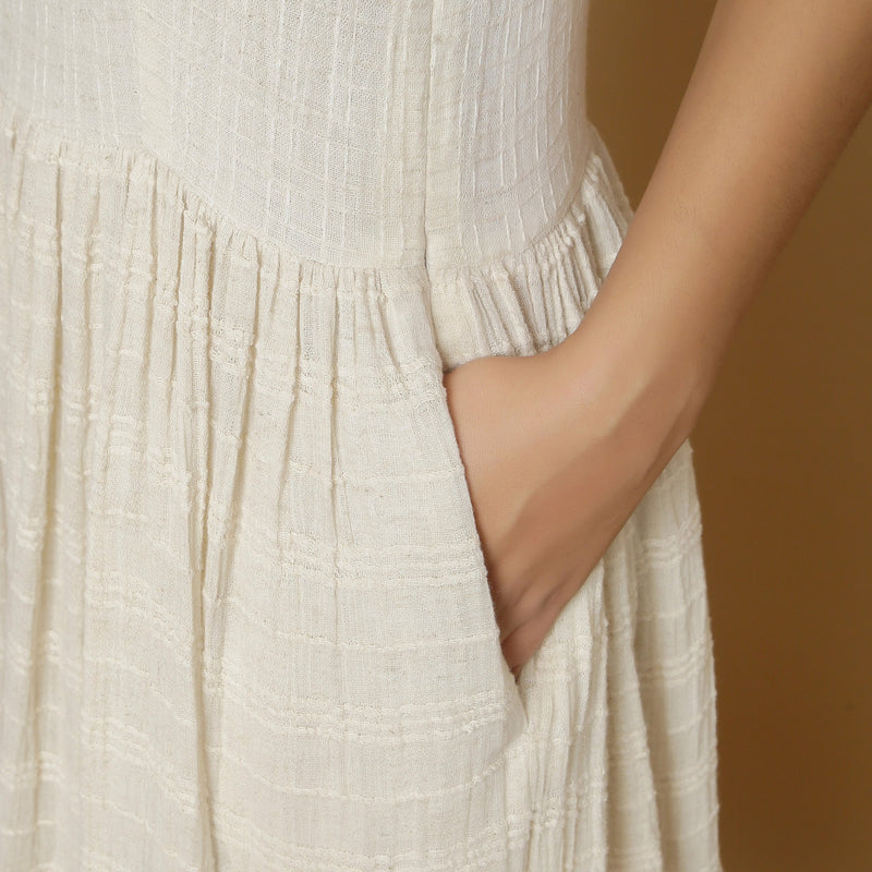 Left Detail of a Model wearing Strappy Undyed Cotton Flax Maxi Dress