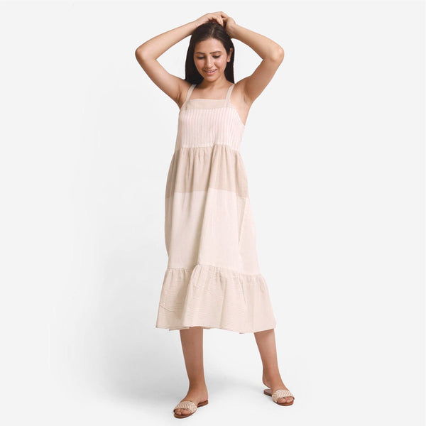 Front View of a Model wearing Strappy Yarn Dyed Cotton Gathered Tier Dress