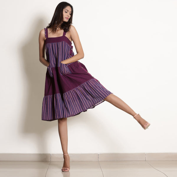 Front View of a Model wearing Striped Berry Wine Strappy Tier Dress